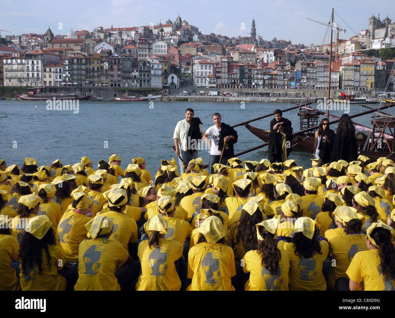 A  hazing ritual for new Porto university students in Gaia, Portugal, showing the Porto waterfront, and the River - Stock Image