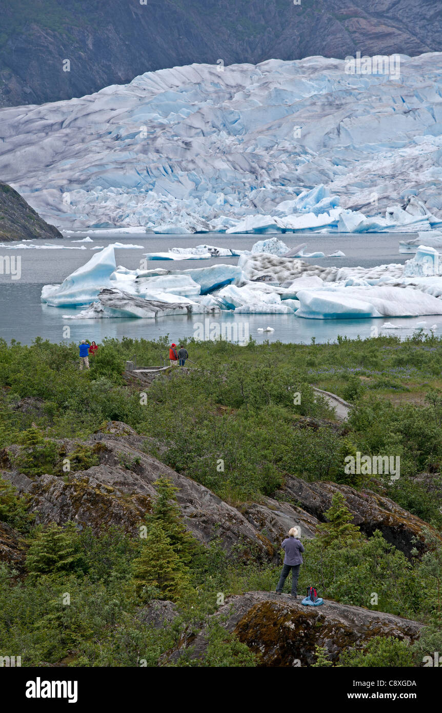 Tourists contemplating the Mendenhall glacier. Juneau. Alaska. USA Stock Photo