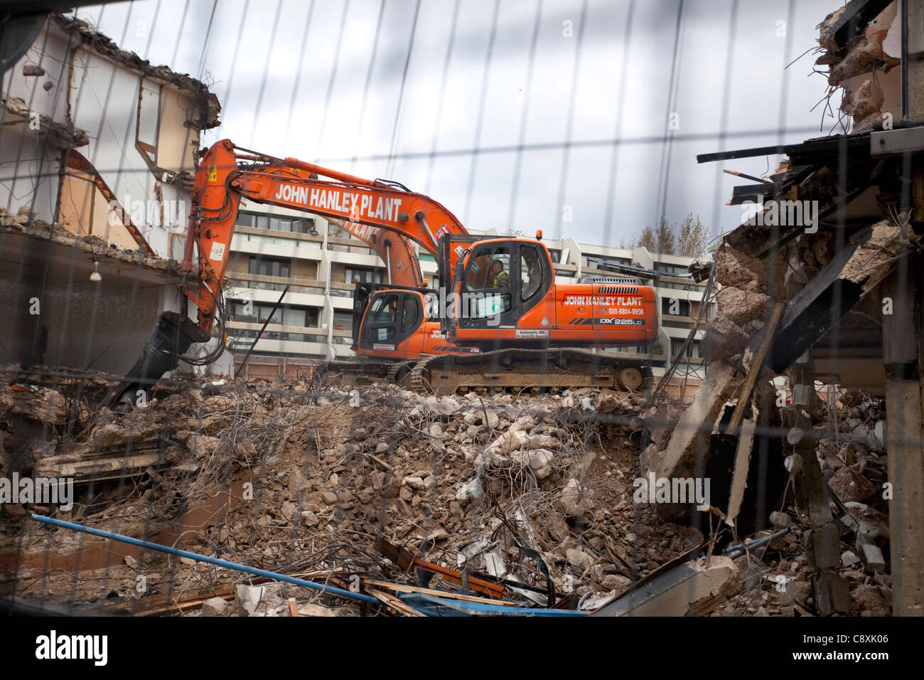 Demolition site and mechanical excavator - Stock Image