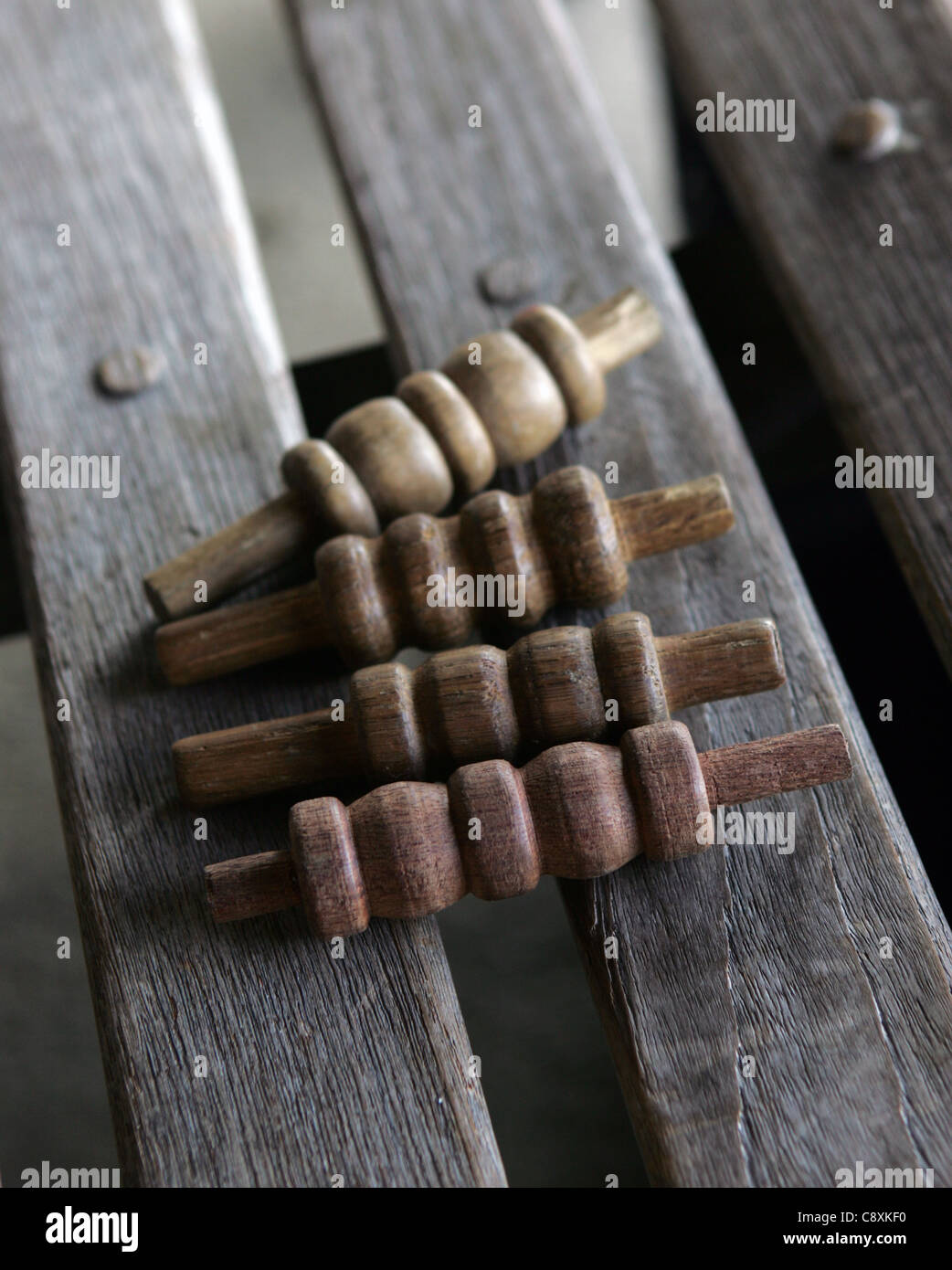 Cricket bails on a bench. - Stock Image