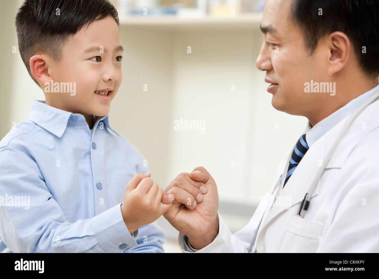 Young Boy and Doctor Pinky Promise - Stock Image