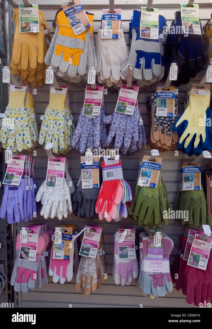 Gardening is a major leisure industry as suggested by this display rack of garden gloves in different styles and - Stock Image