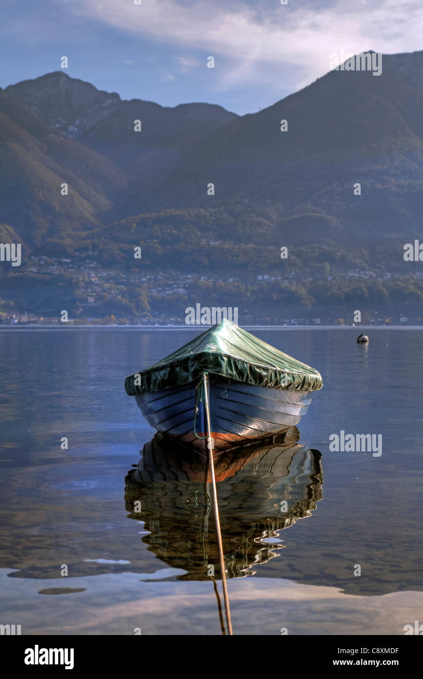 a covered rowing boat on the Lake Maggiore - Stock Image