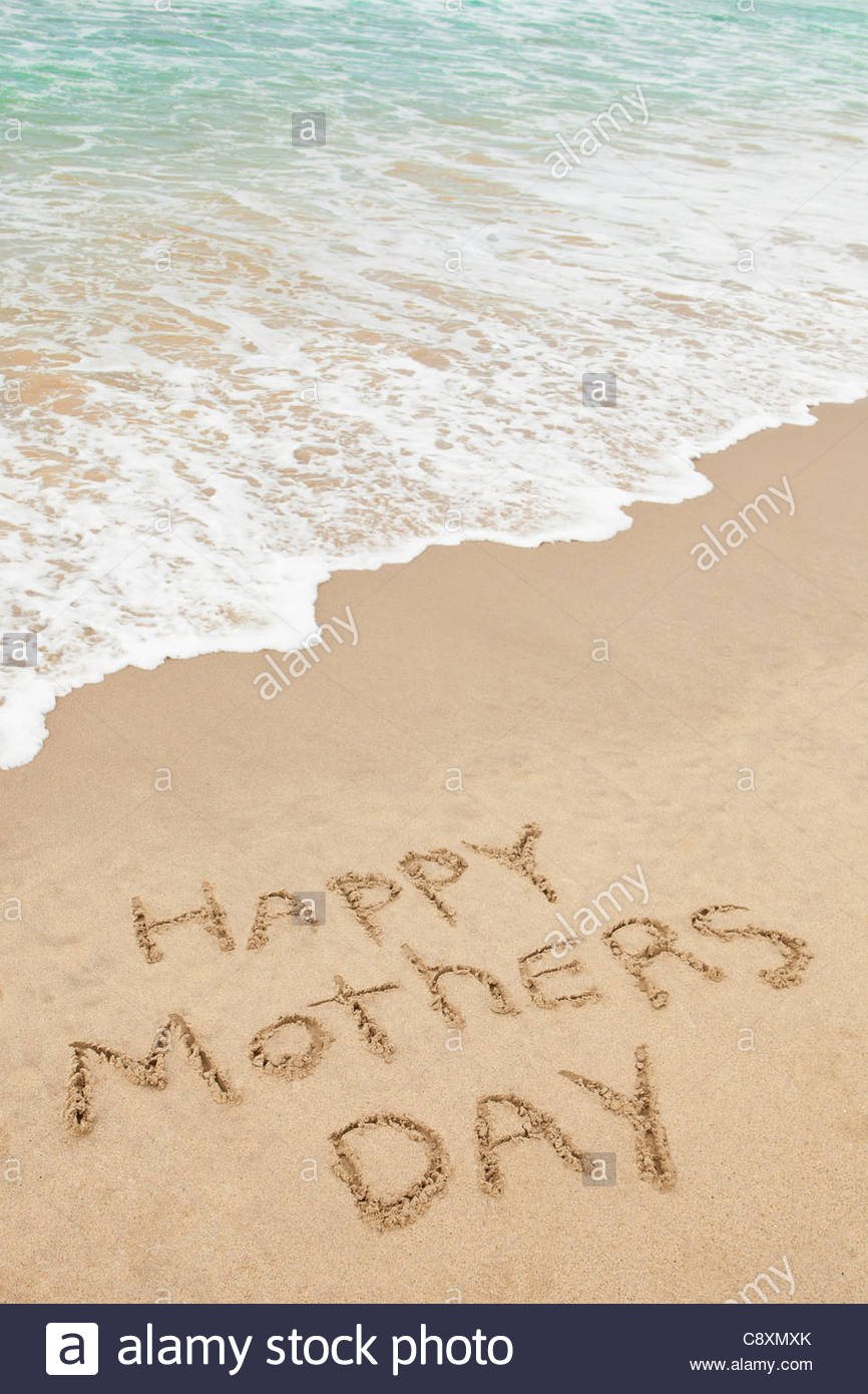 USA, California, Hermosa Beach, Happy mothers day written in sand on beach - Stock Image