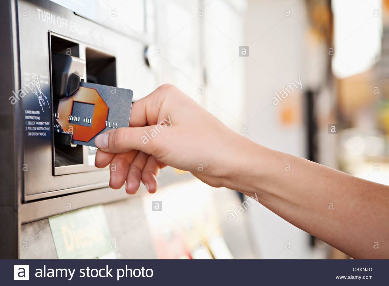USA, California, Lawndale, Female hand inserting card into tam - Stock Image