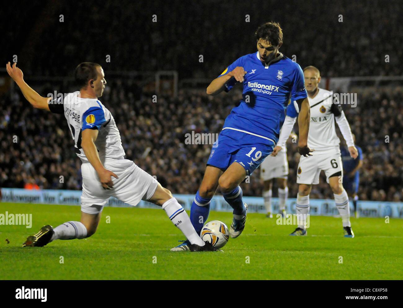 Birmingham City No.19 Nikola Zigic is tackled by Club Brugge No.24 Daan Van Gijseghem  Birmingham City v Club Brugge. Stock Photo