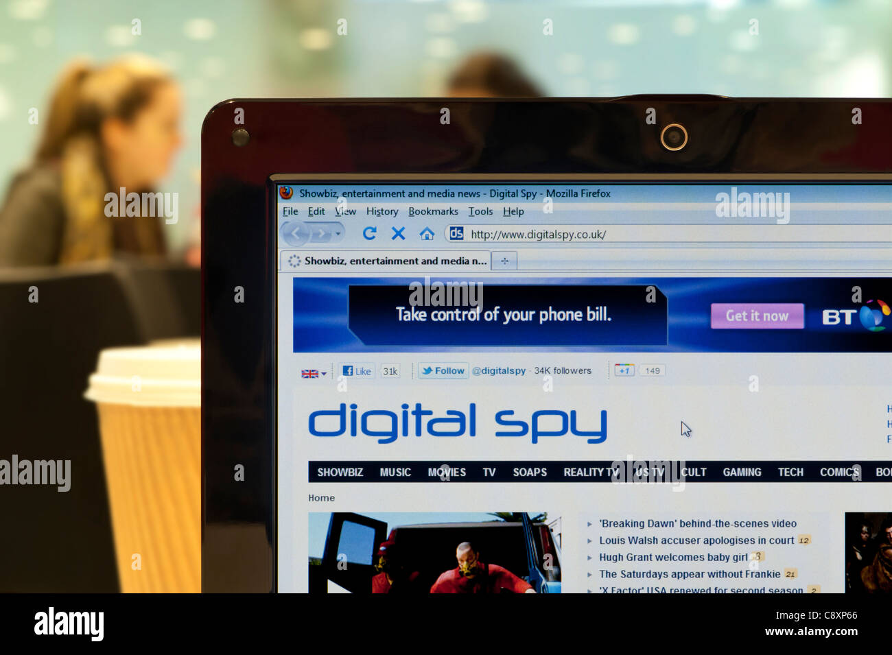 The Digital Spy website shot in a coffee shop environment (Editorial use only: print, TV, e-book and editorial - Stock Image
