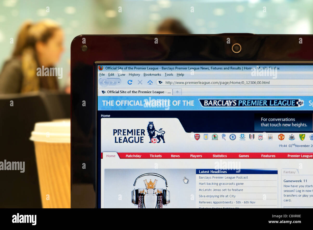 The Premier League website shot in a coffee shop environment (Editorial use only: ­print, TV, e-book and editorial - Stock Image