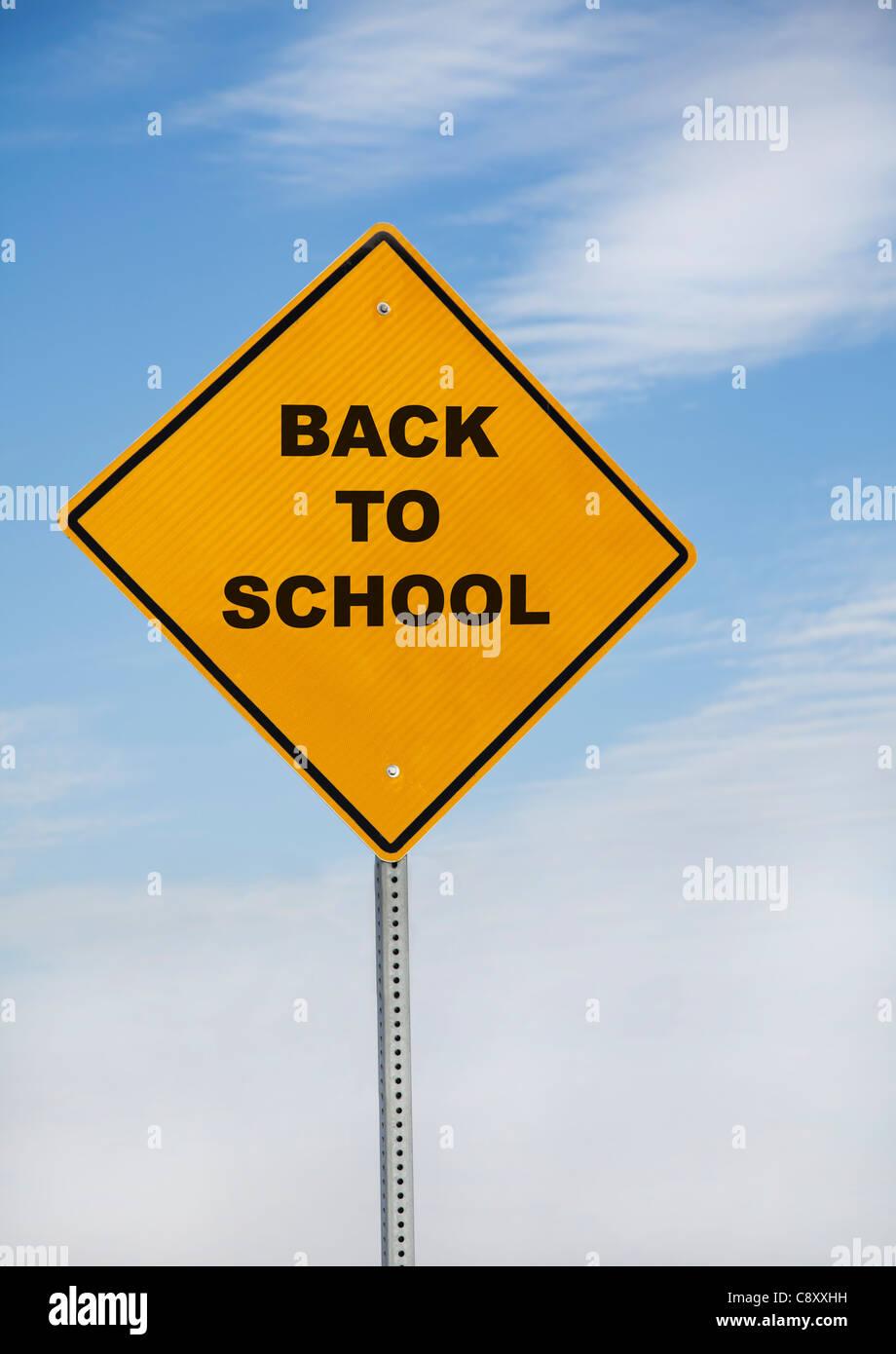 USA, Illinois, Metamora, back to school sign against sky - Stock Image