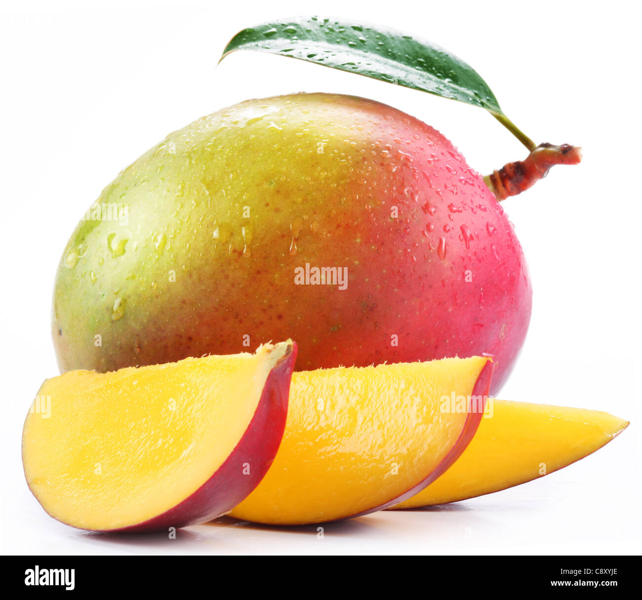 Mango with slices on a white background. - Stock Image