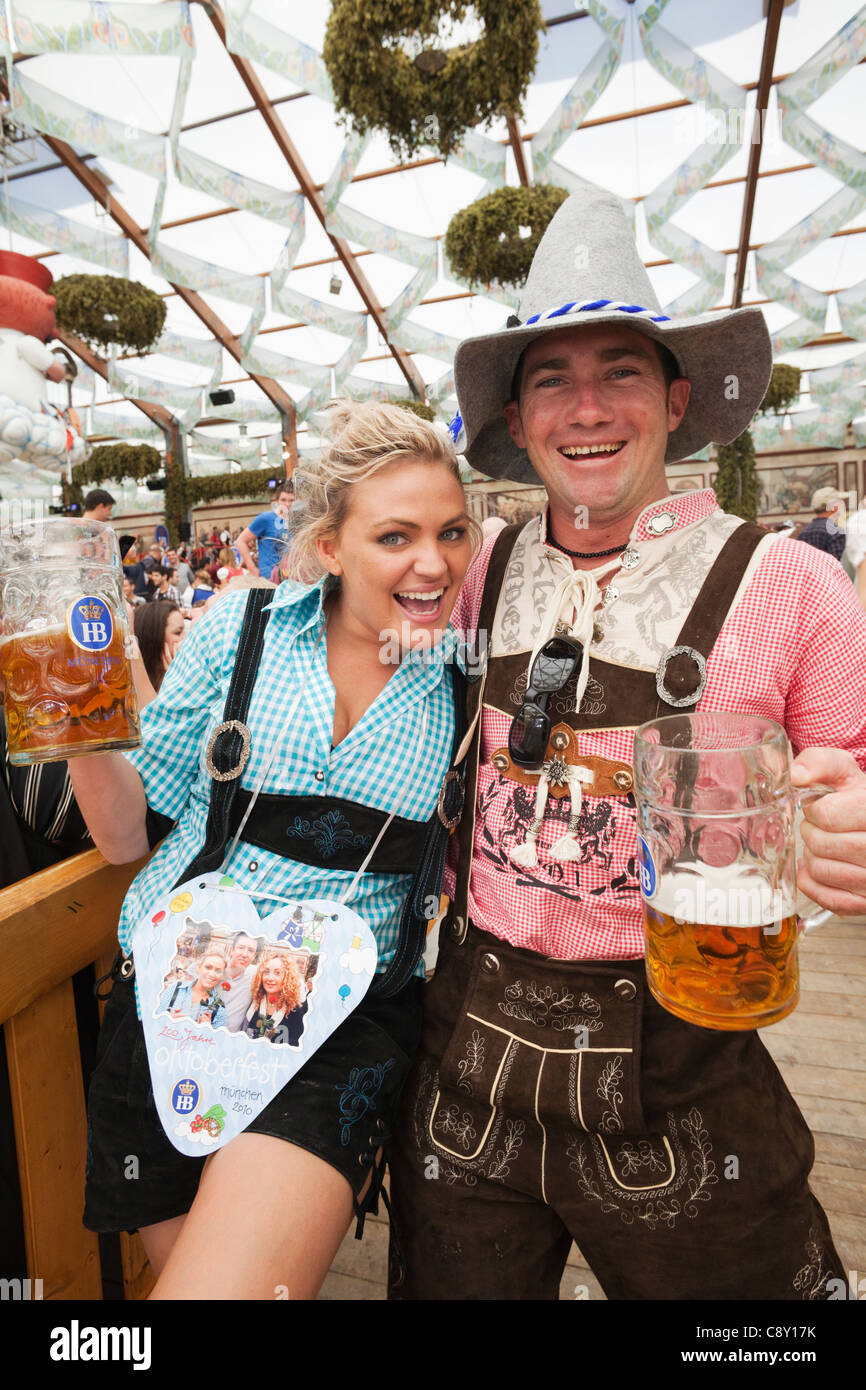 Germany Bavaria Munich Oktoberfest Couple in Baverian Costume Drinking Beer  sc 1 st  Alamy & Germany Bavaria Munich Oktoberfest Couple in Baverian Costume ...