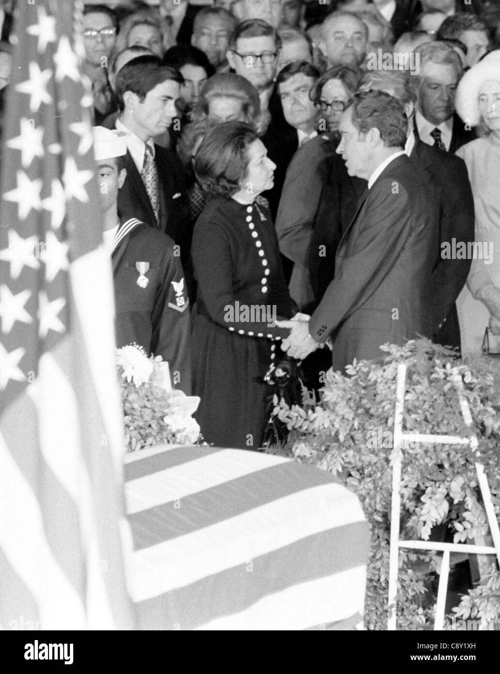 President Nixon offering condolences to Lady Bird Johnson with casket in the foreground. LBJ funeral ceremonies - Stock Image