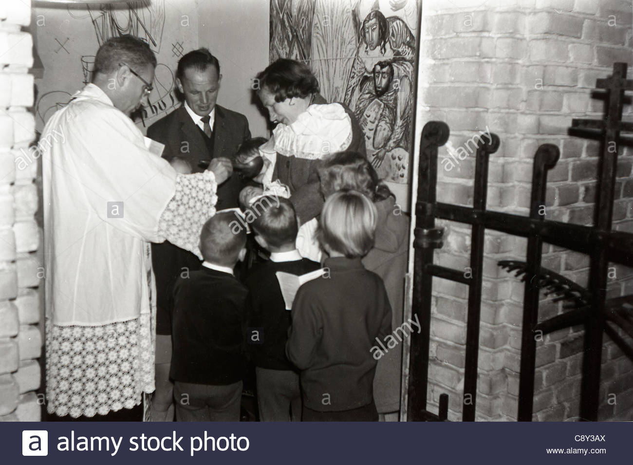 baptising of a baby with family 1960s Holland - Stock Image