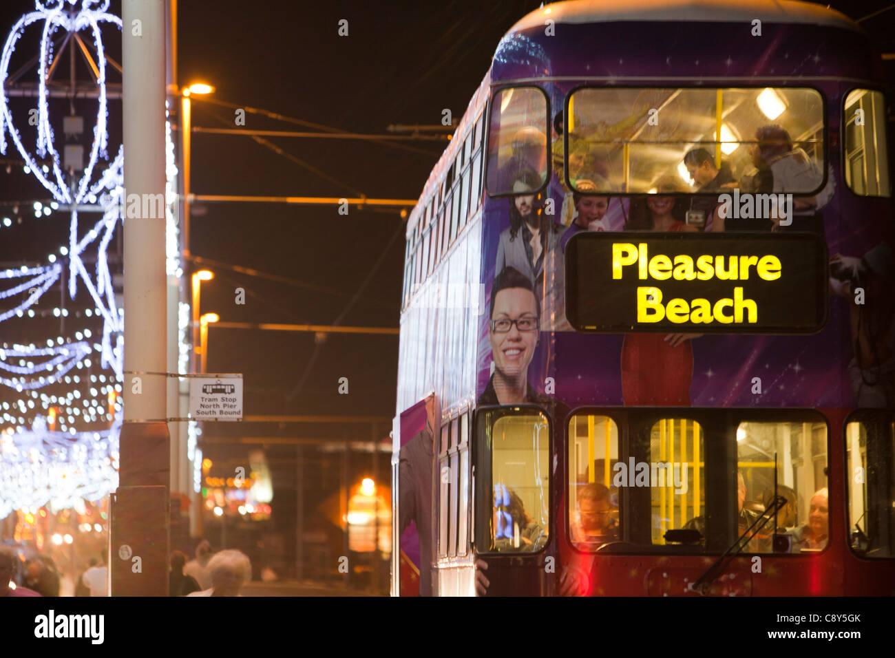 A bus on the promenade during the annual, Blackpool Illuminations, Blackpool, Lancashire, UK. - Stock Image