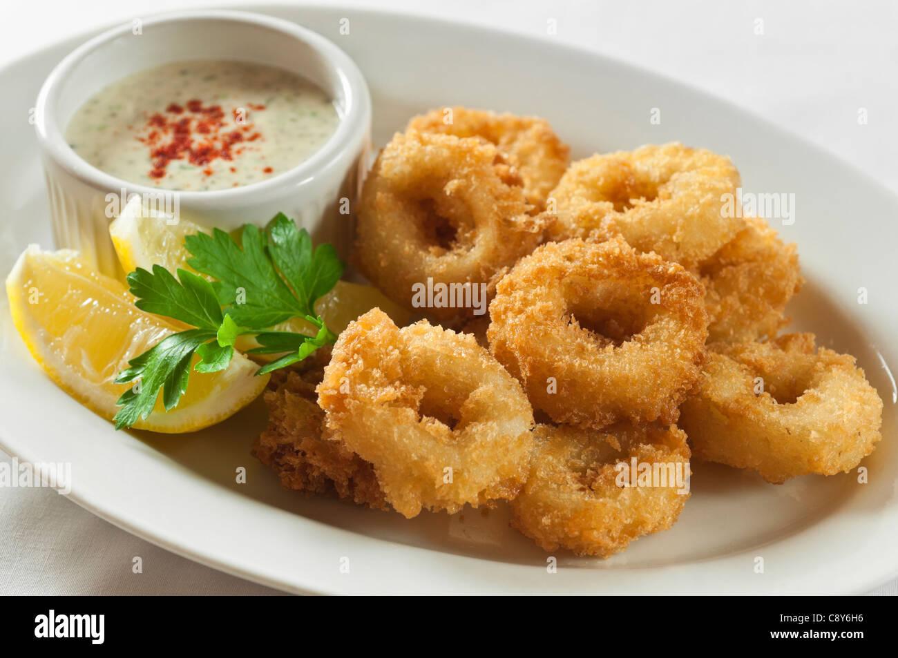 Deep fried calamari or squid - Stock Image