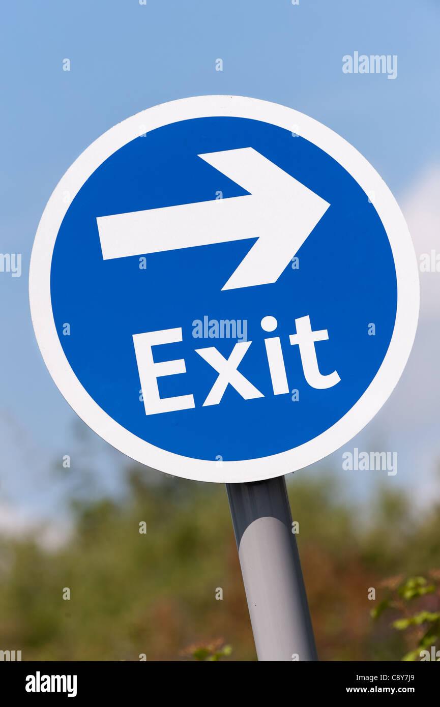 A Blue and white Exit English street Sign - Stock Image