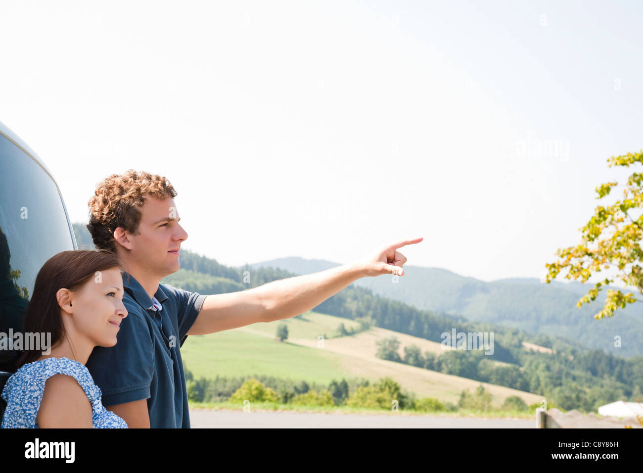 portrait of young couple on a road trip - Stock Image