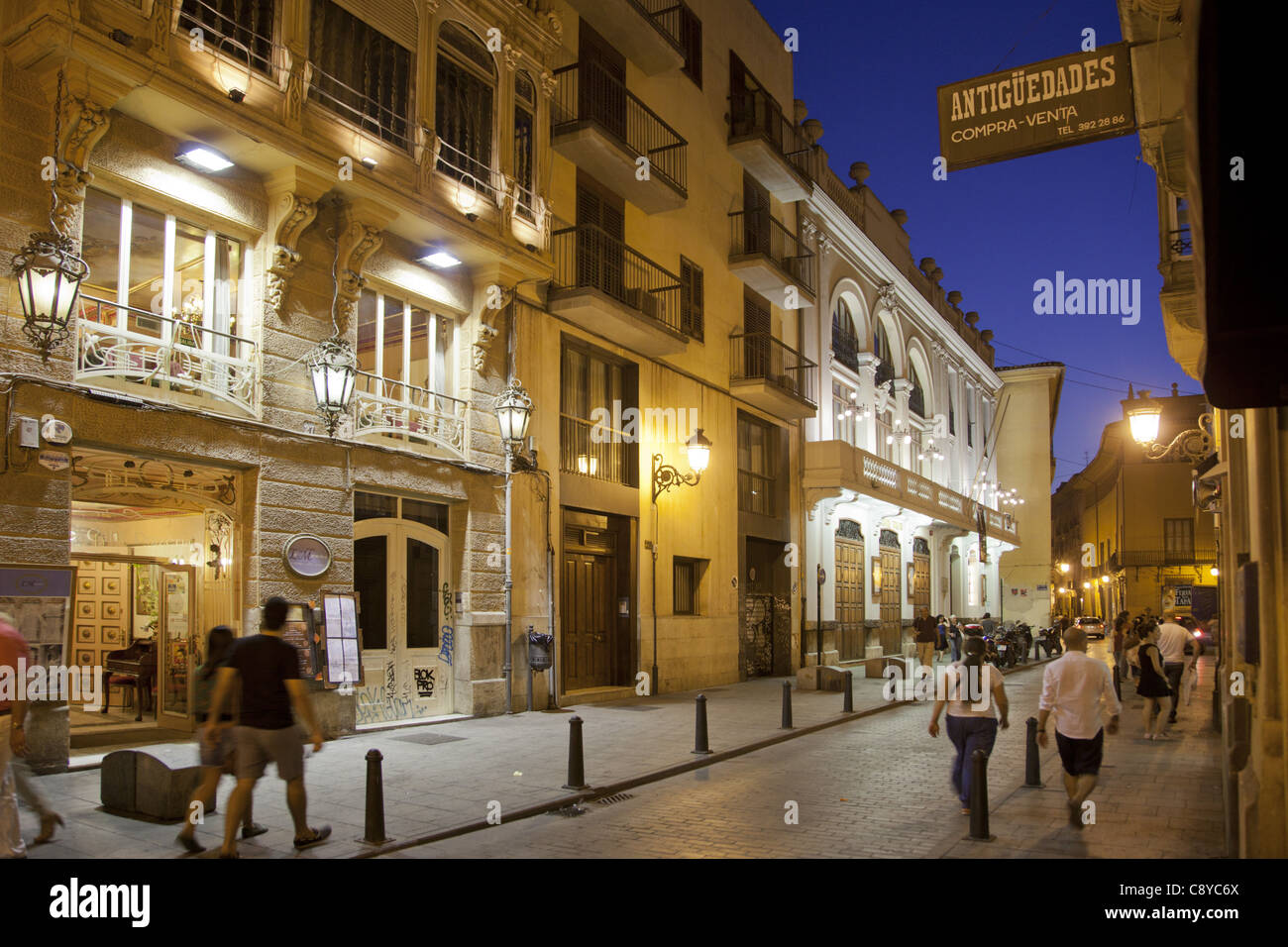 Restaurants and Theater in Calle Cavallers in El Carmen at night Valencia, Spain - Stock Image