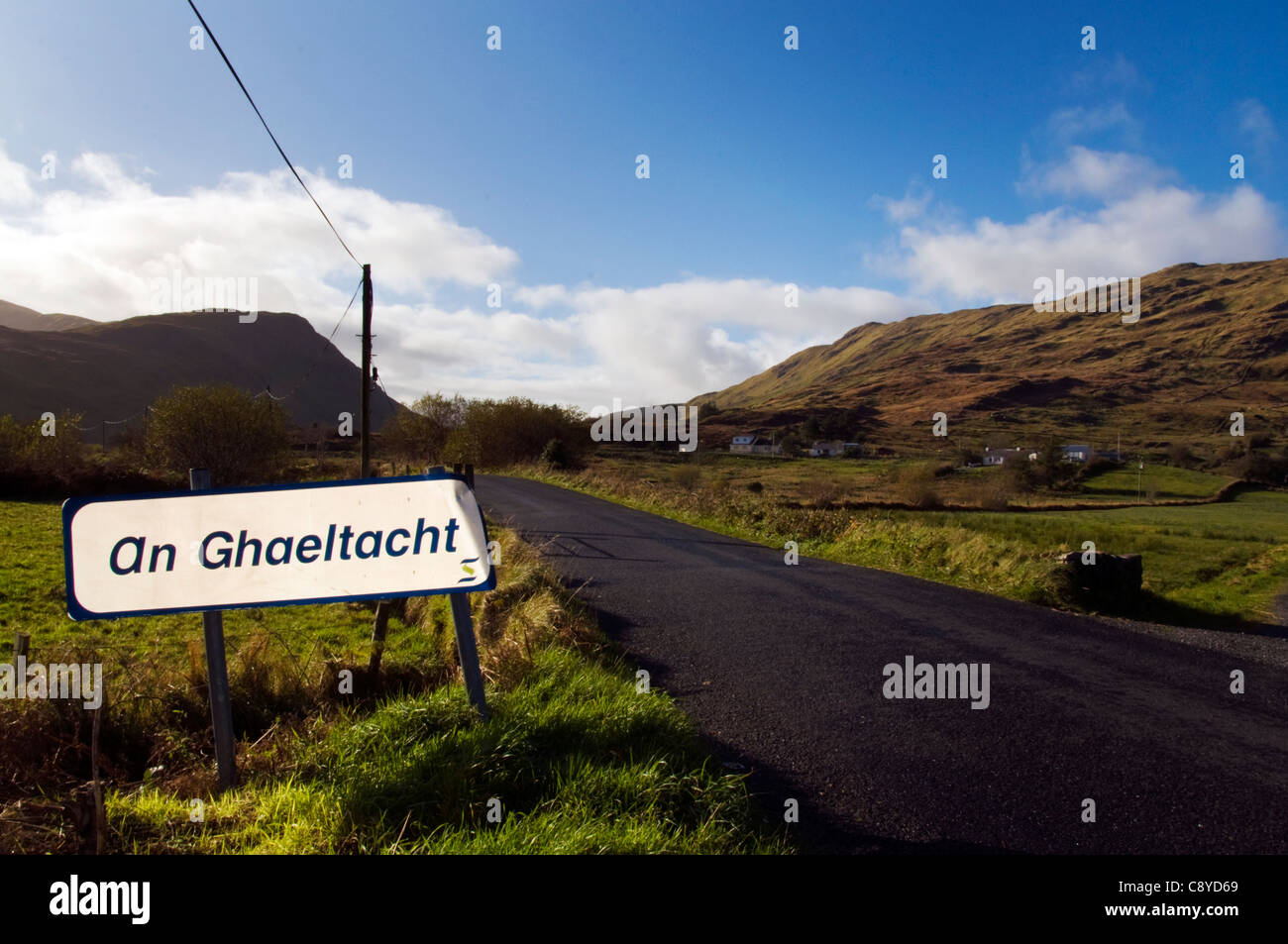 An Ghaeltacht road sign signpost in rural Ireland - Stock Image
