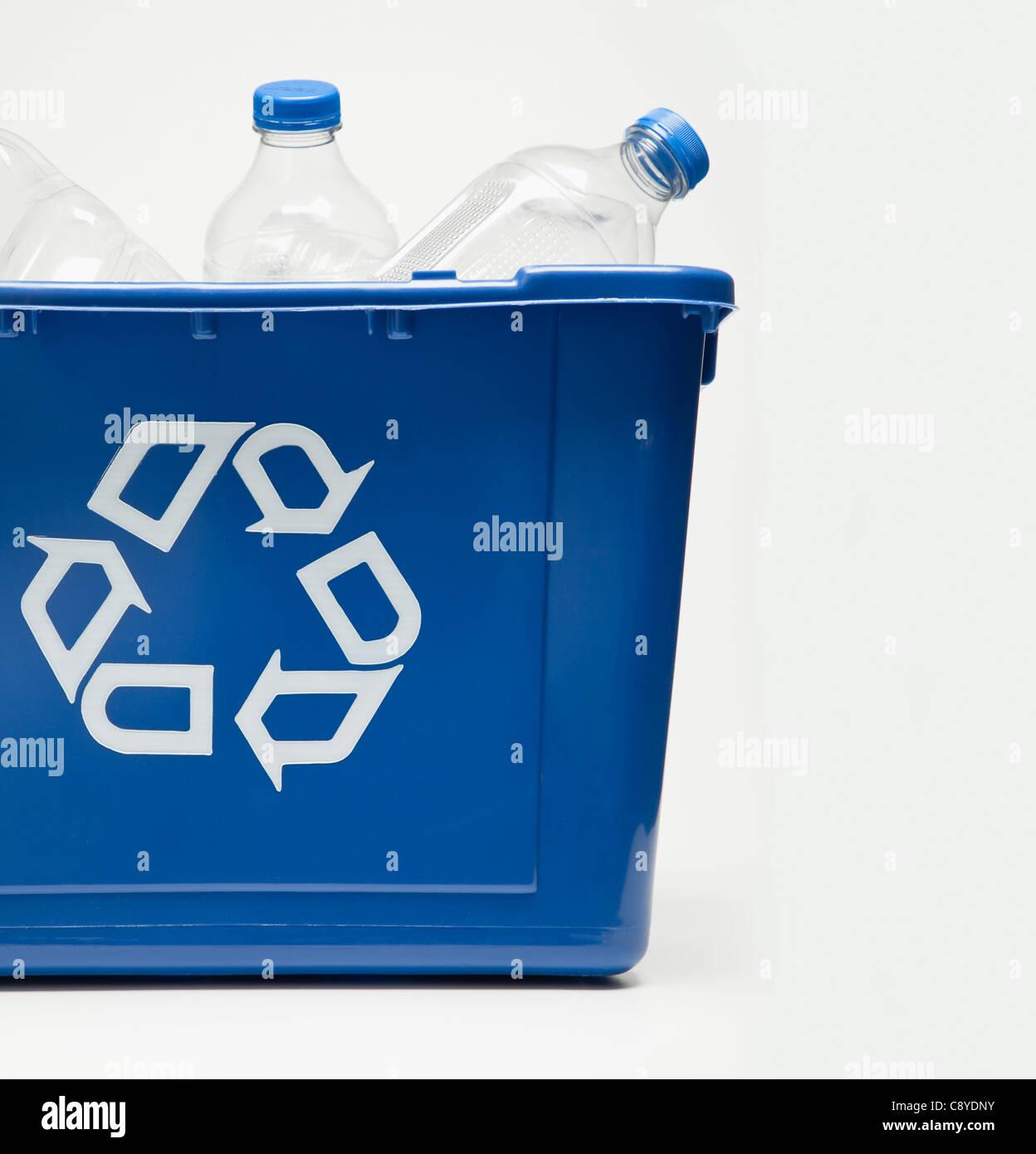 Recycling bin with plastic bottles, studio shot - Stock Image