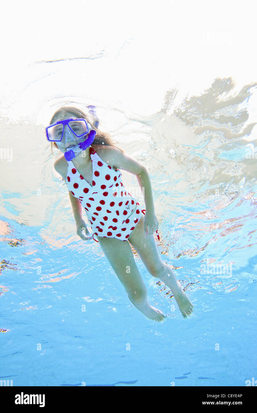 USA, Florida, St. Petersburg, Girl (10-11) diving in swimming pool Stock Photo