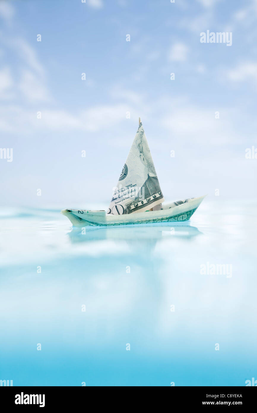 USA, Florida, St. Petersburg, Boat made of fifty dollar banknote floating on water - Stock Image