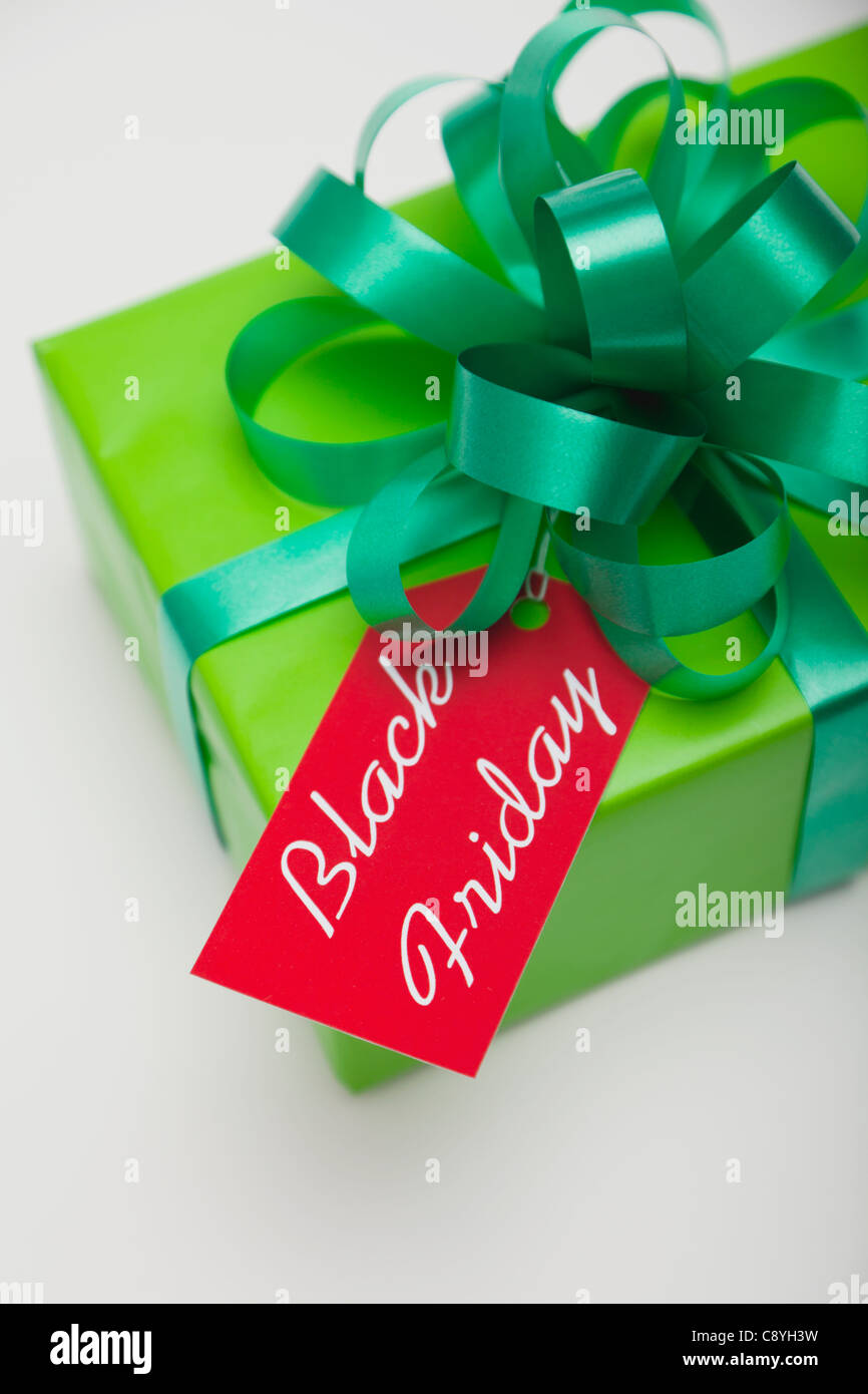 Studio shot of gift with Black Friday tag - Stock Image
