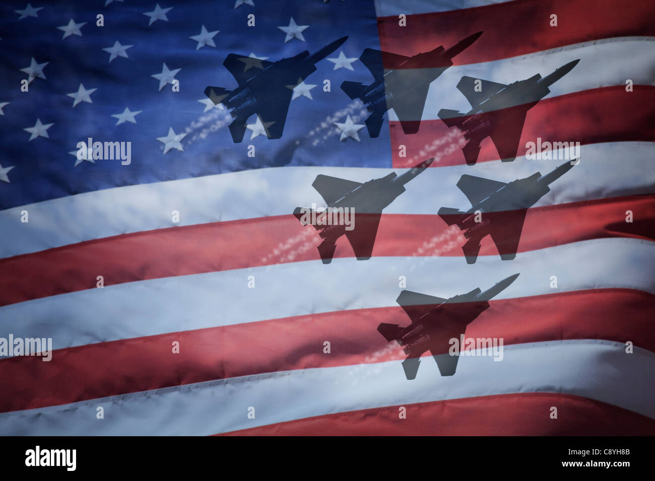 Close-up of American flag with silhouettes of F-16 airplanes - Stock Image