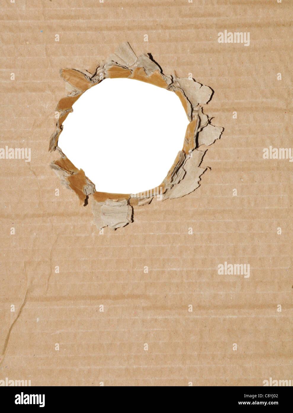 Cardboard hole - Stock Image