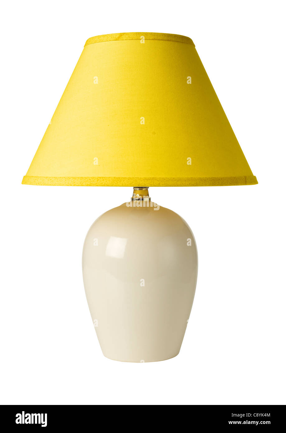 White ceramic lamp with yellow shade - Stock Image