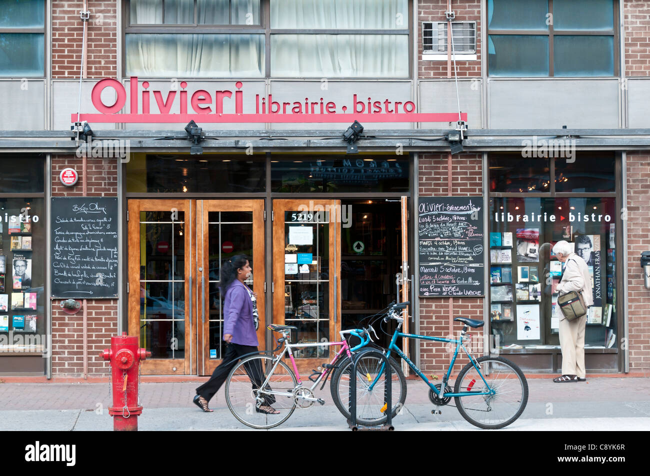 Street scene and french language bookstore on Cote des Neiges street Montreal Quebec - Stock Image