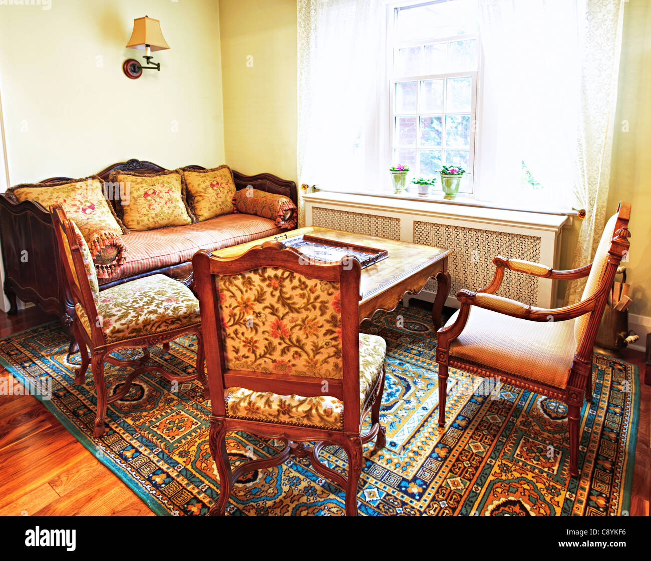 Antique furniture in living room interior of home - Stock Image
