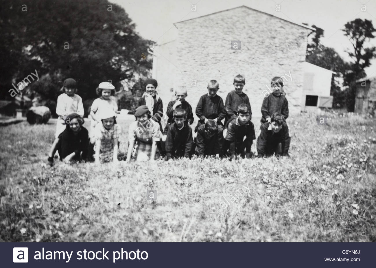 class rural France posing with teachers during a horseback play game France 1930s - Stock Image