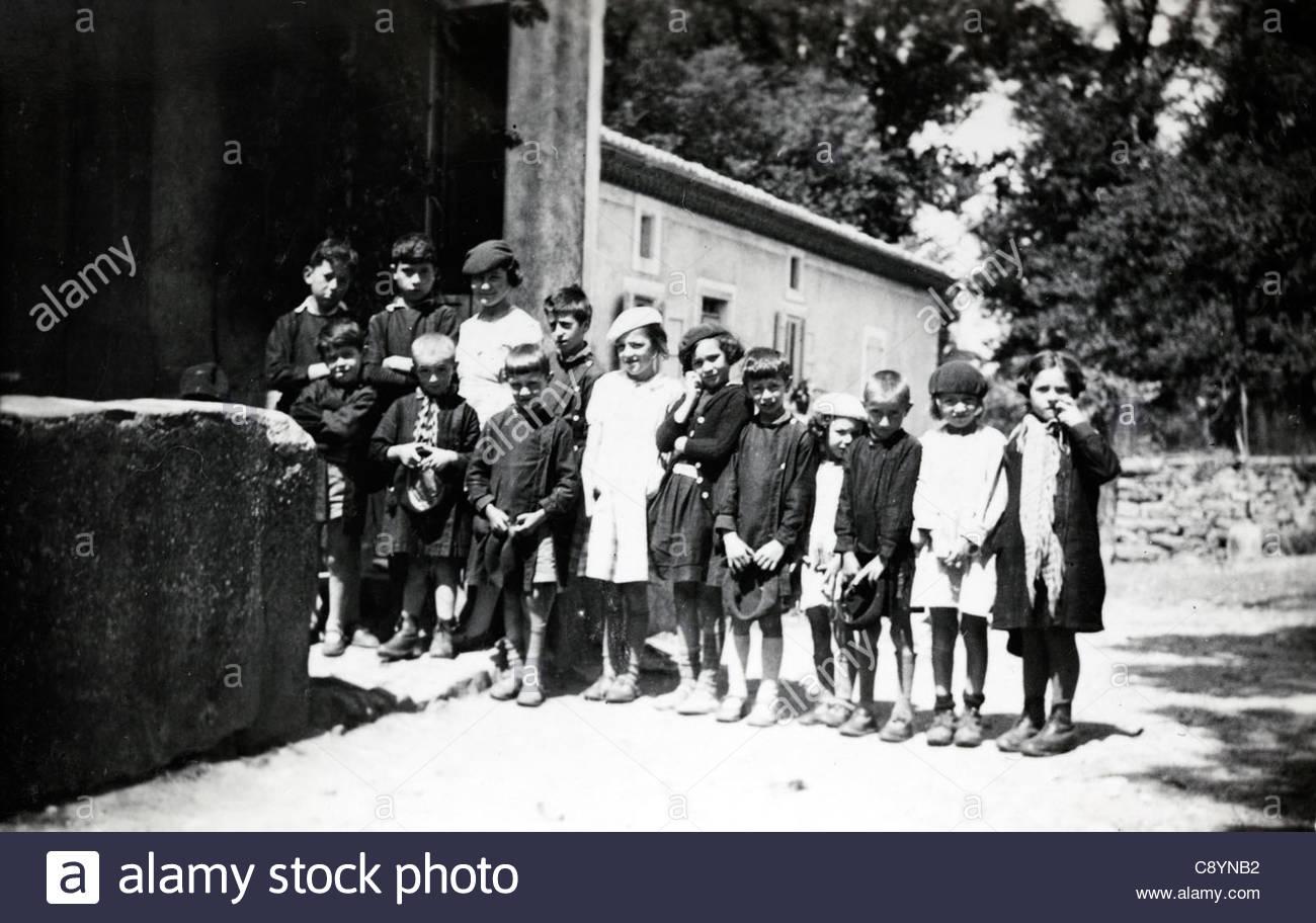 schoolchildren with teacher group photo rural France - Stock Image