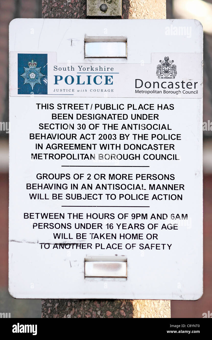 Antisocial behaviour warning notice posted on a lamp post in Thorne. - Stock Image