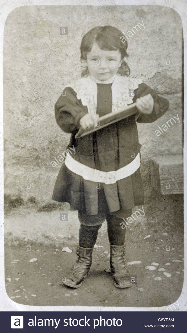 schoolchild with a small personal chalkboard France - Stock Image