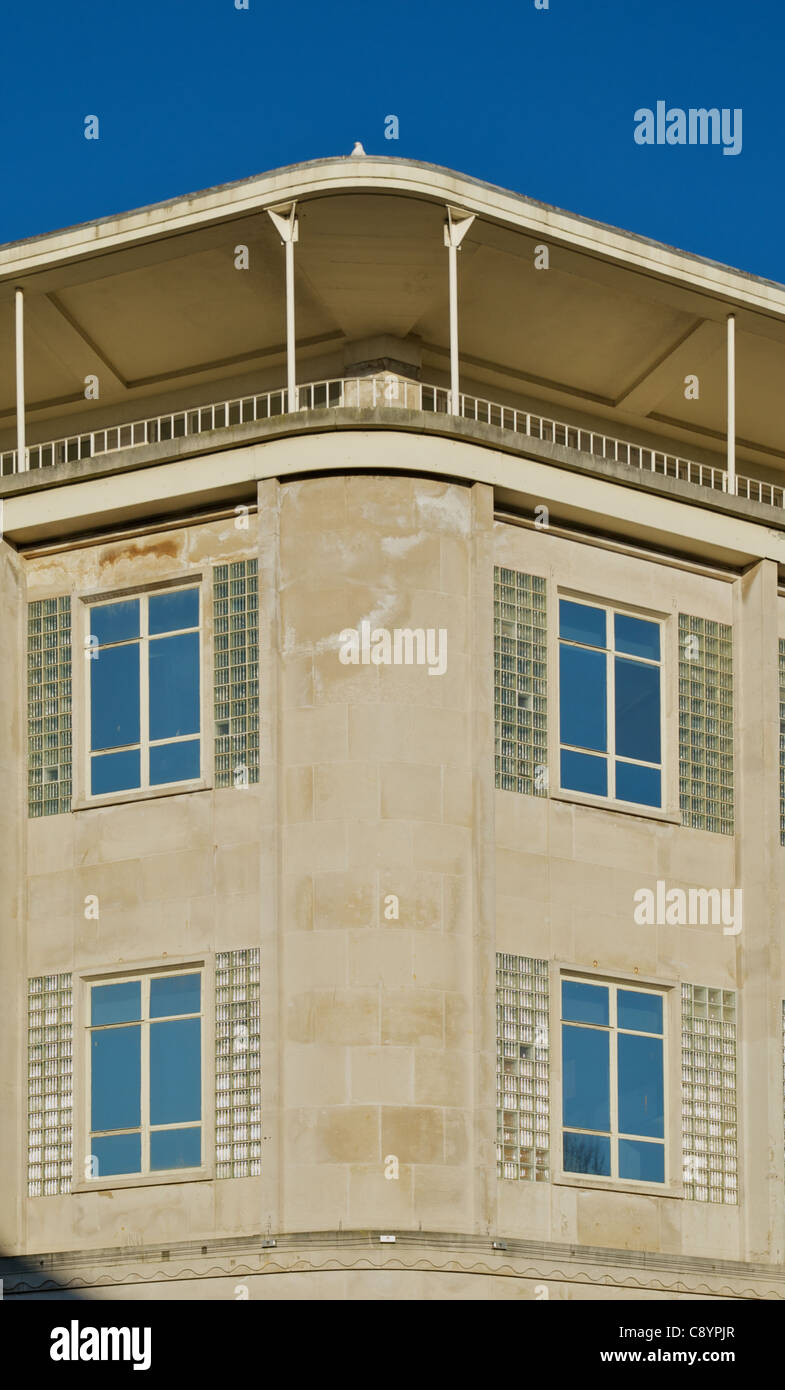 Detail view of south west corner of former department store. Portland stone facade, overhanging canopy roof. - Stock Image