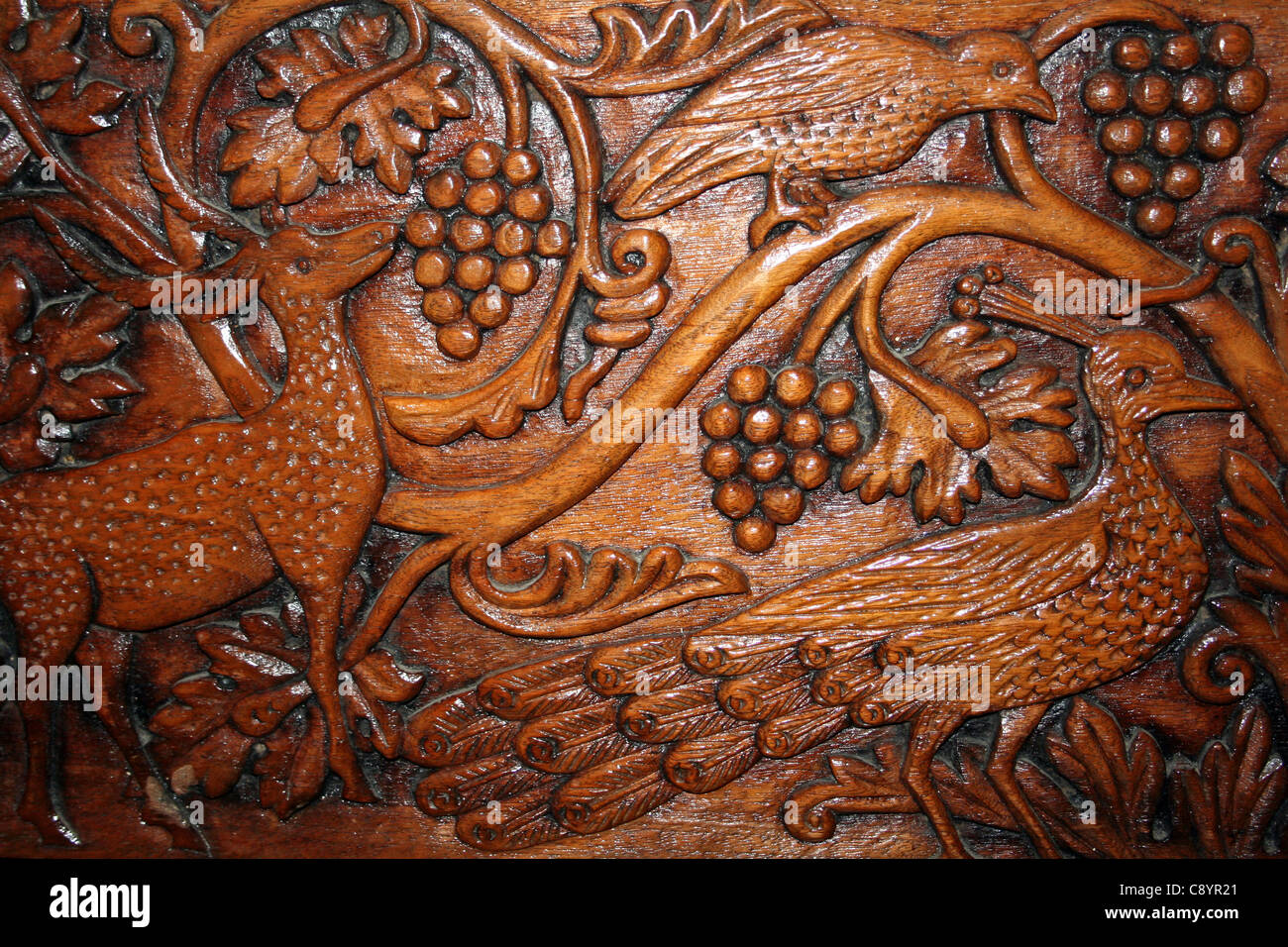 Carved Wood Panel Depicting Deer, Peacock And Bird - Stock Image