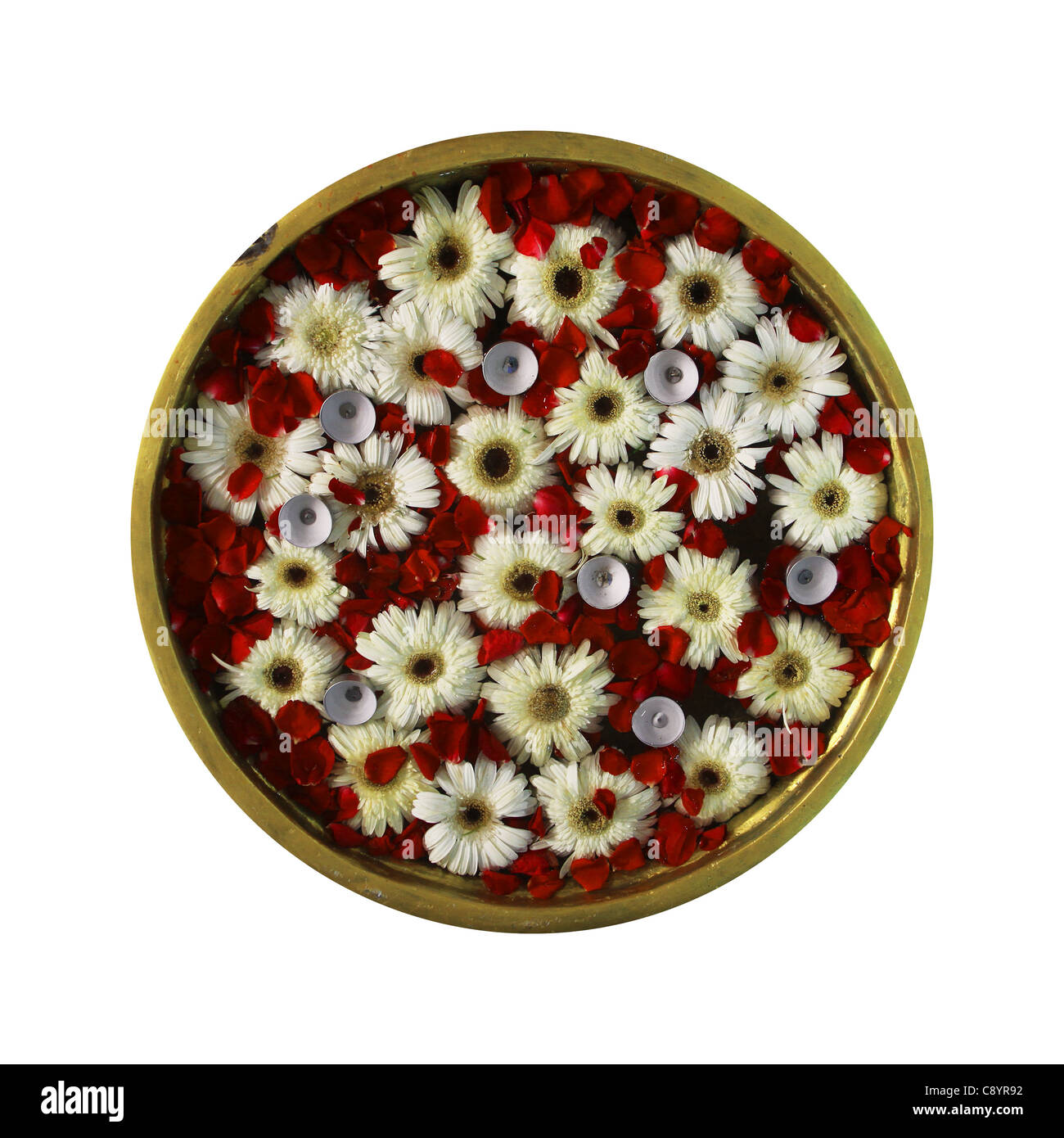 flowers arrangement floating on water in vessel - Stock Image