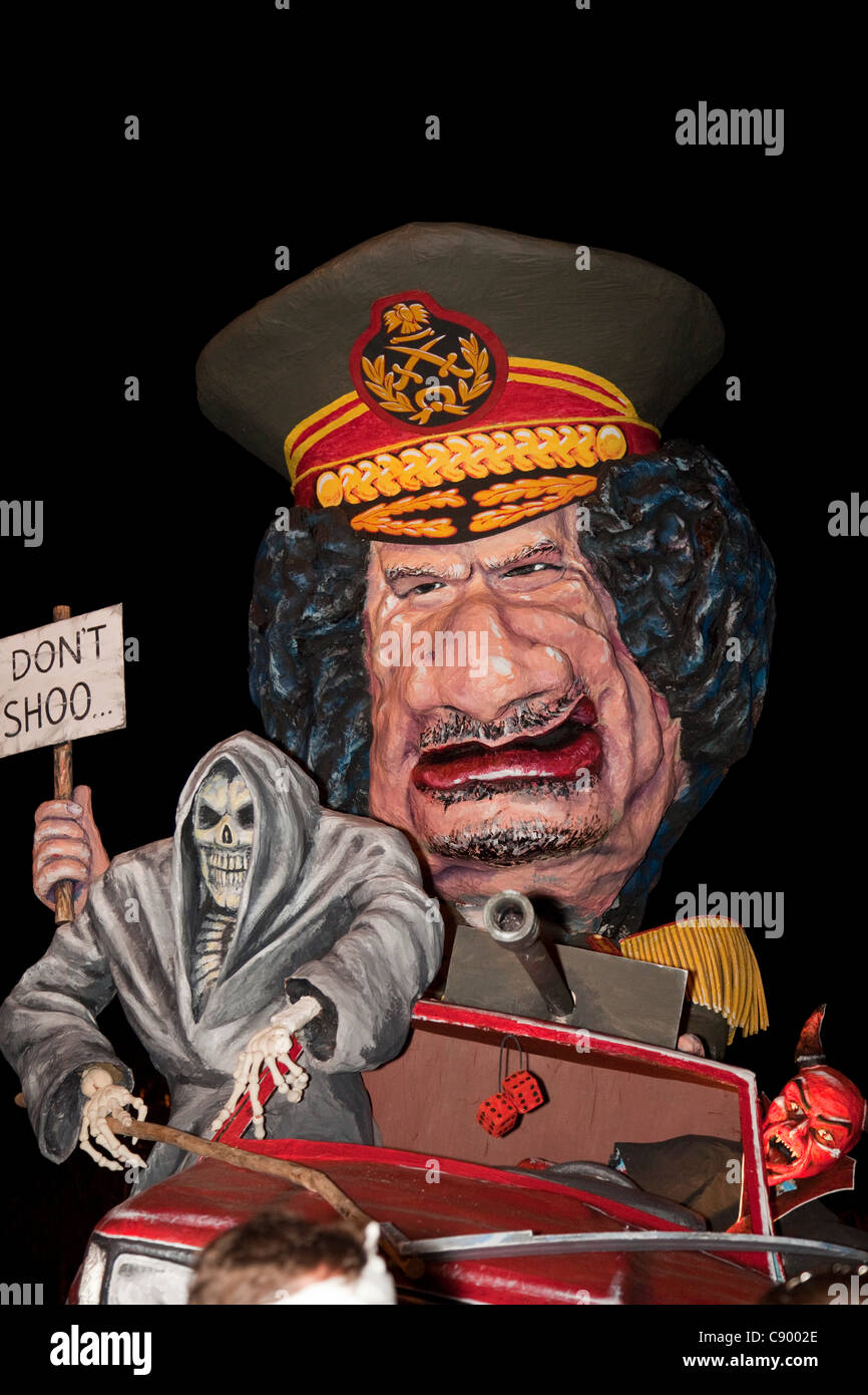 A giant effigy of the ex Libyan dictator Muammar Gaddafi is paraded through the streets of Lewes during the annual - Stock Image