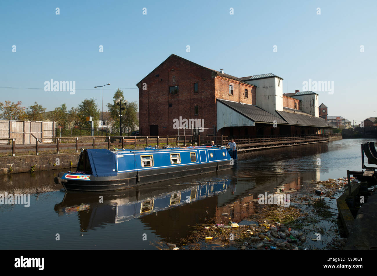 A narrowboat on the Leeds and Liverpool Canal at Wigan Pier, Wigan, Greater Manchester, England, UK - Stock Image