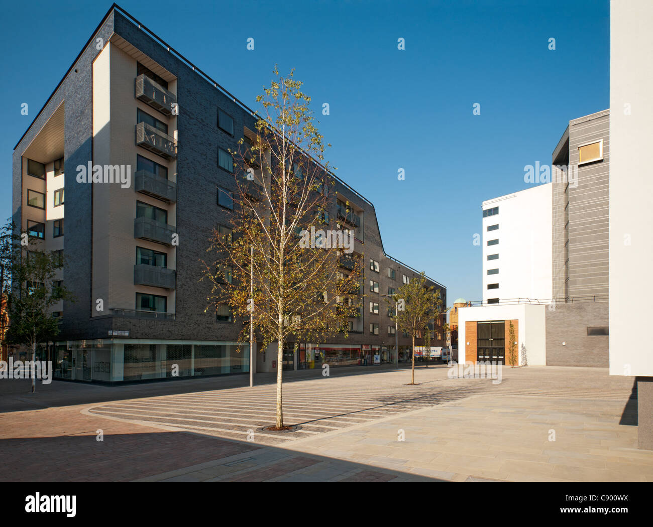 Premier Apartment block and the new (2011) public realm area, Smithfield Square.  Northern Quarter, Manchester, - Stock Image
