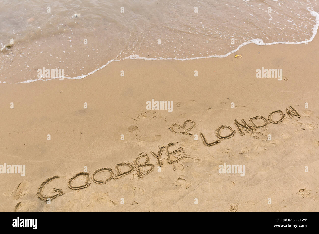 Thames, London, South Bank at Blackfriars - Goodbye London written in clean, unpolluted riverside sand - Stock Image