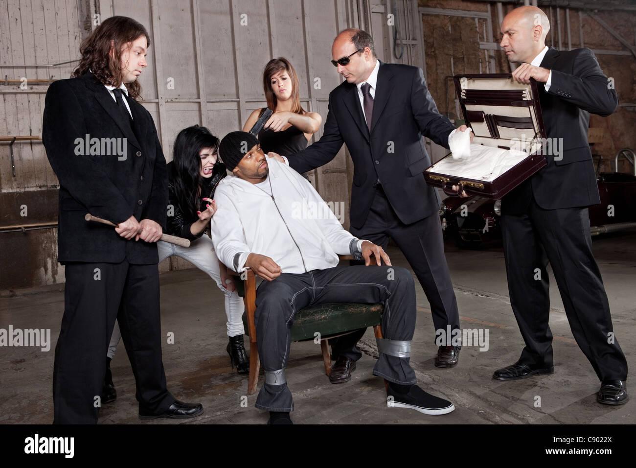 Mafia Interrogation over a drug deal gone wrong. - Stock Image