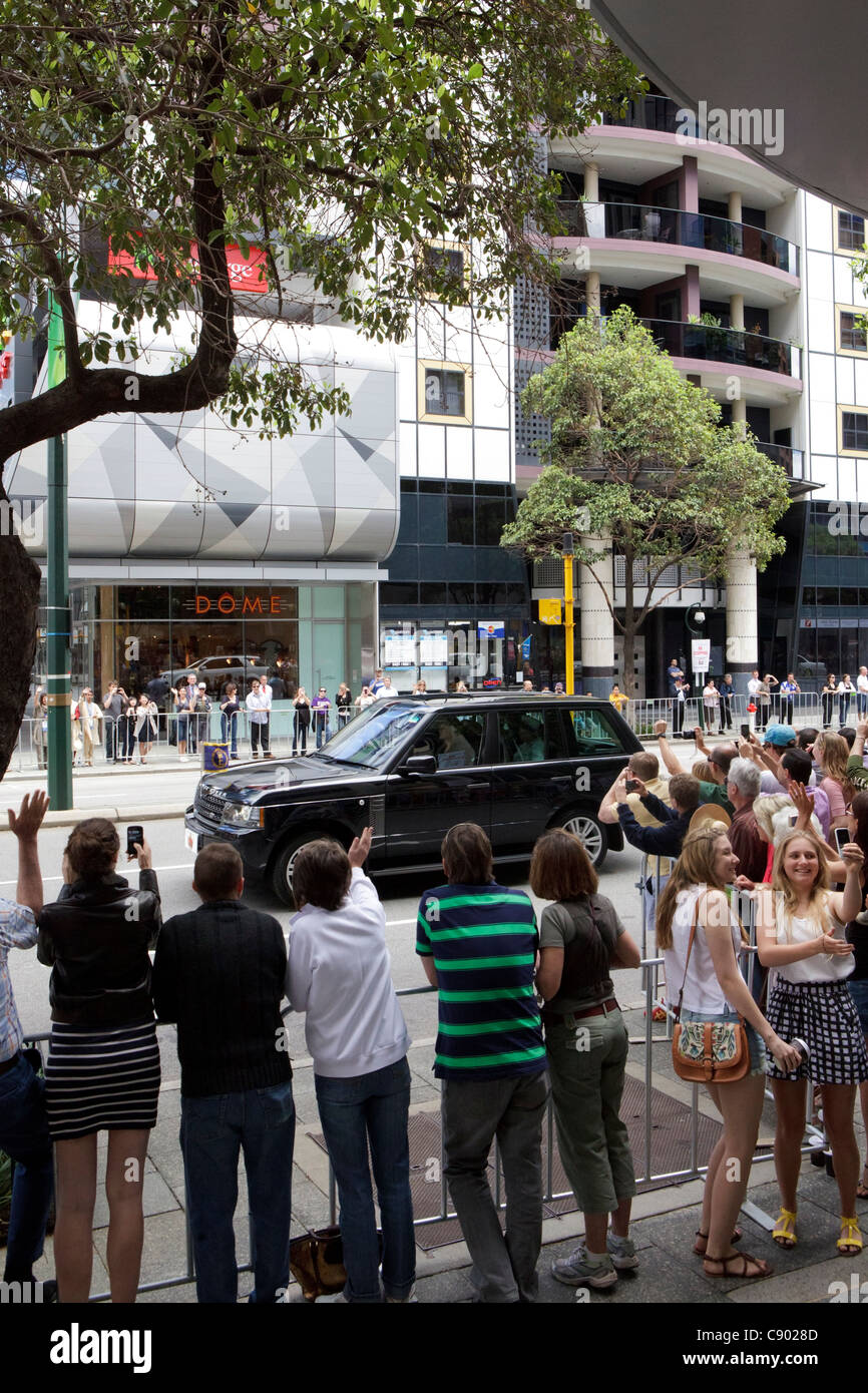 The Queen and the Duke of Edinburgh go past crowds of people in a Range Rover on the last day of their Australian - Stock Image