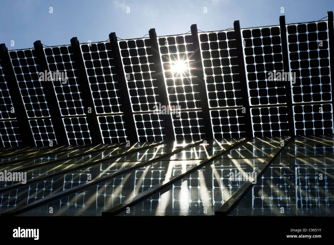 Photovoltaic panels on a solar powered roof - Stock Image