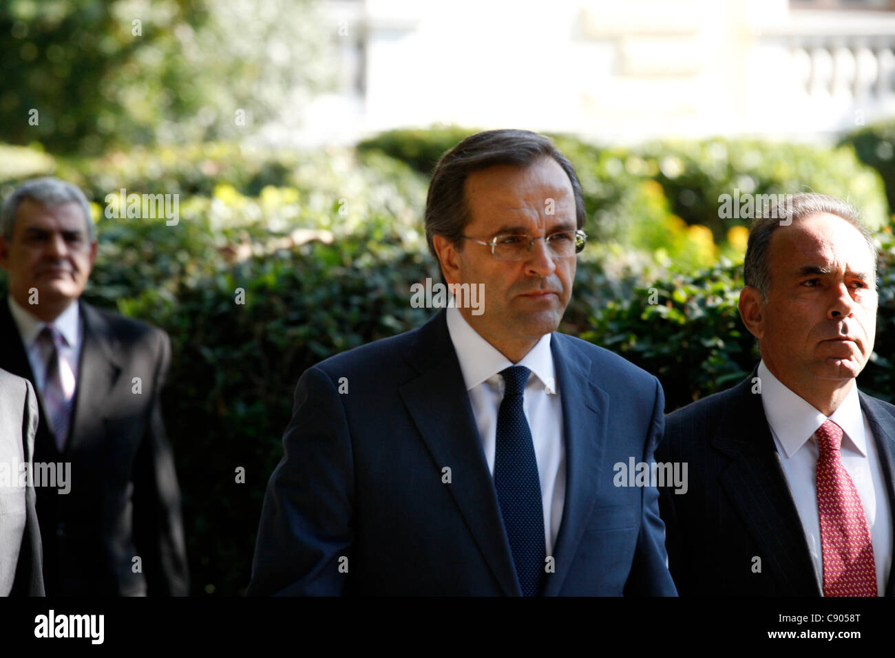 6 November 2011 Athens Greece. Conservative opposition leader Antonis Samaras(M) exists Presidential house after - Stock Image