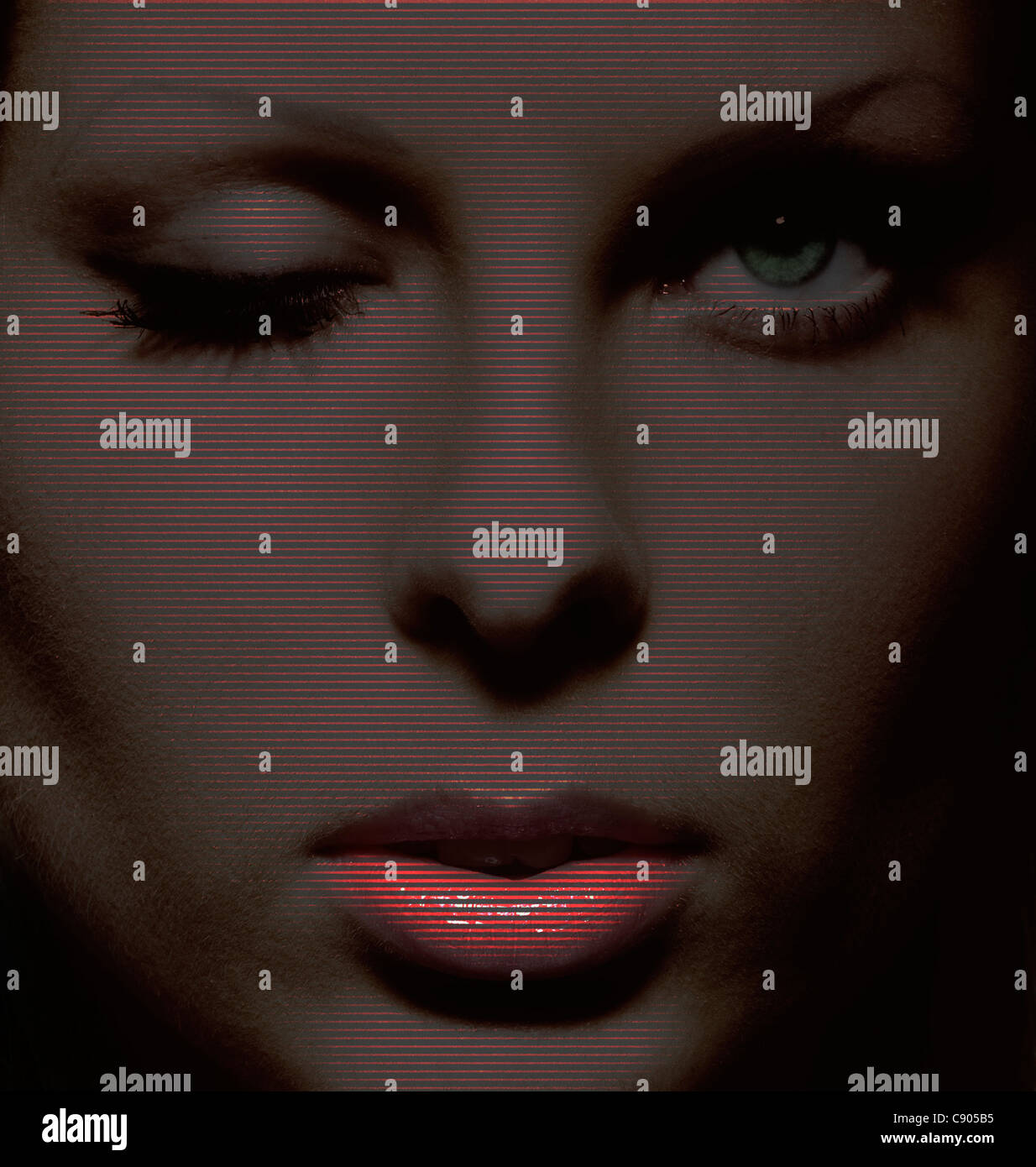 Female face with lines going through it.Television,scanning,lines per inch, communication,screen,vision,view,Big - Stock Image