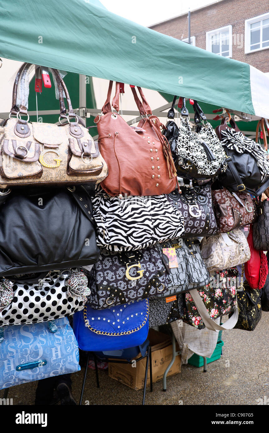 Ladies Handbags For Sale On A Market Stall In Southampton Uk Stock