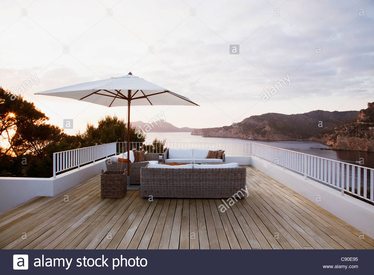 Patio furniture on modern deck - Stock Image